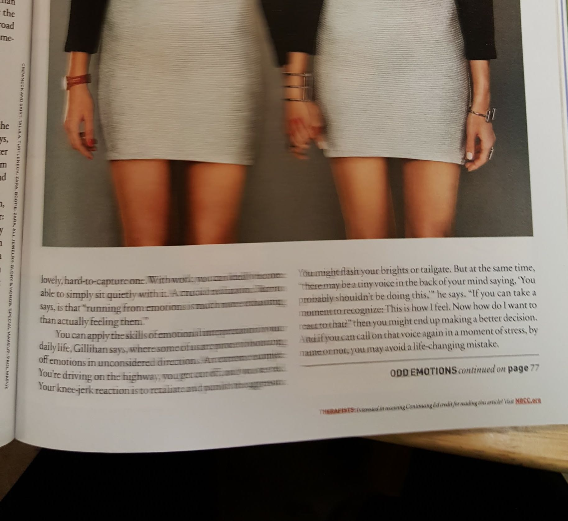 Two women in white dresses with black sleeves are holding hands. The text of